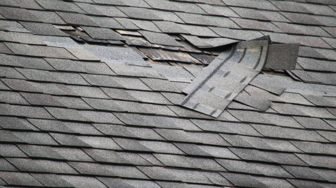 Damaged Asphalt Roofing Shingles On A Roof In Wheaton, Illinois