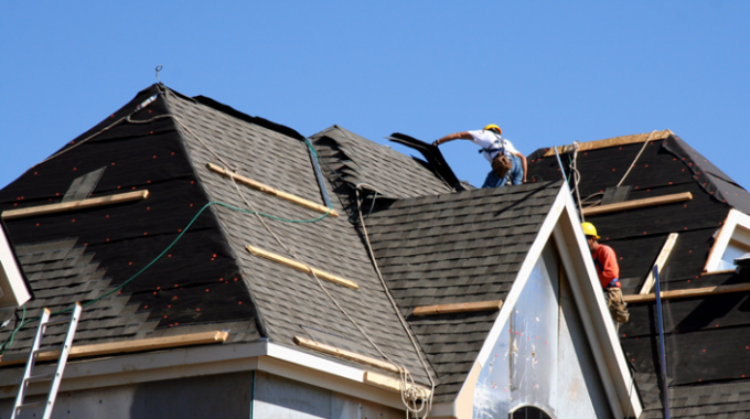 Roofing Contractors Installing A Roof On A House In Glen Ellyn, Illinois