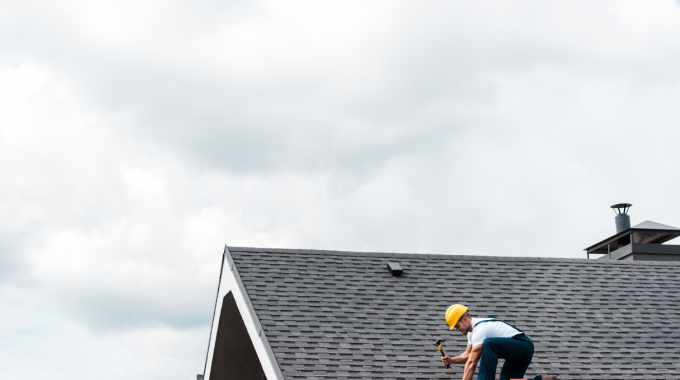 Roofing Contractor Repairing A Roof After A Storm In Tinley Park, Illinois